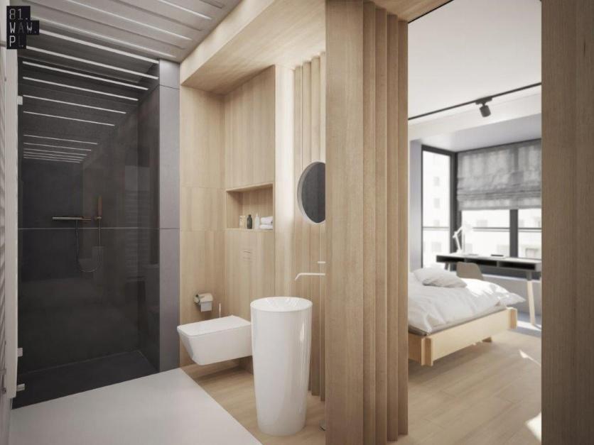 Biel, drewno i wanna - idealna łazienka dla gości