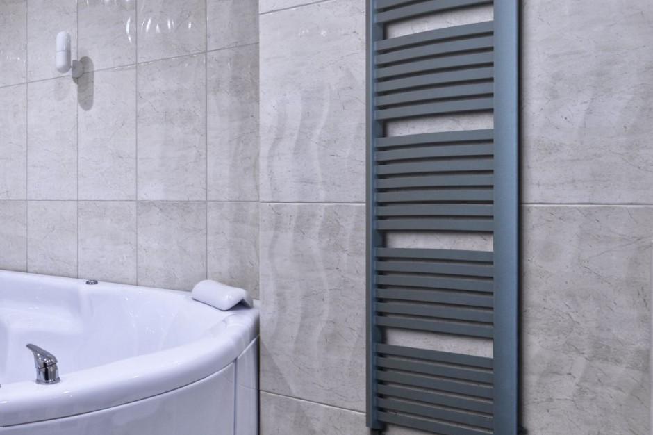 Mocny akcent w łazience: postaw na grafitowy grzejnik