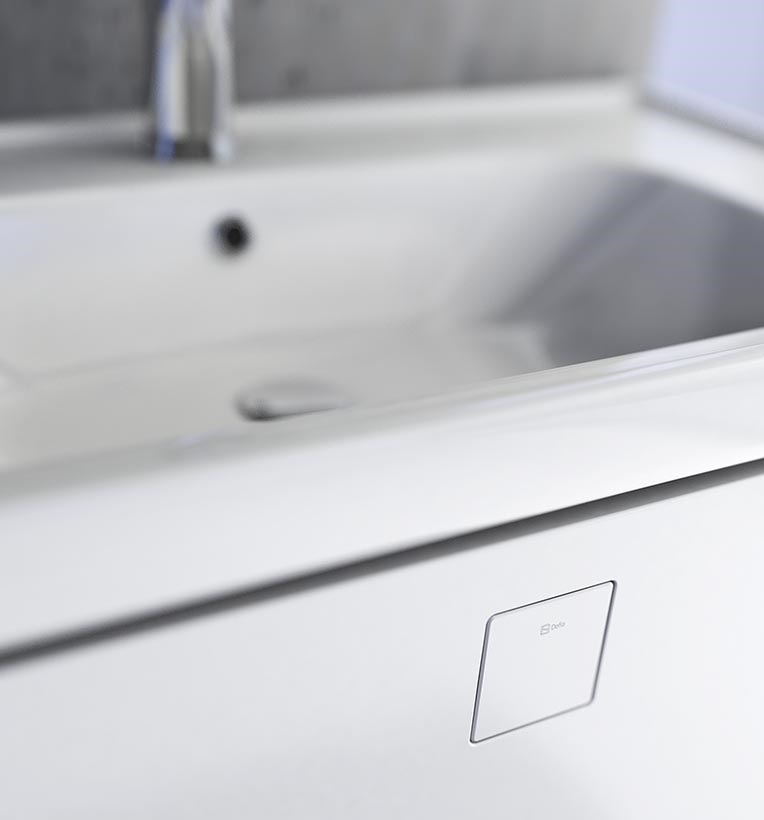 Kolekcja mebli łazienkowych NODO z unikalnymi uchwytami. Fot. Defra