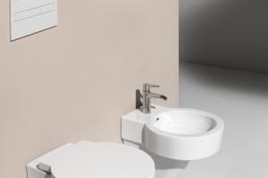 Spójna i elegancka: aranżacja łazienki z designerską kolekcją